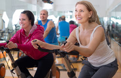 Older people do sports on exercise bikes Stock Photo