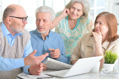 Older people with a laptop. Portrait of older people with a laptop Royalty Free Stock Images