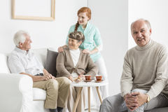 Older people in nursing home. Group older people spending time in common room in nursing home Stock Images