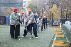 Older people play at miniature golf royalty free stock photo