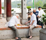 Older people playing street chess Stock Image