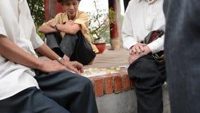 Older people playing street chess near Hoan Kiem stock video