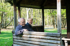 Older people sitting in the arbor. On the forest and relax Stock Photos