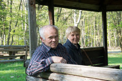 Older people sitting in the arbor. On the forest and relax Royalty Free Stock Photo