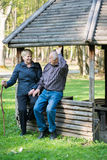Older people sitting in the arbor. On the forest and speaking together Royalty Free Stock Image