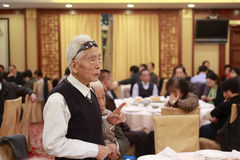 Older people speak at the banquet in a restaurant Stock Photography