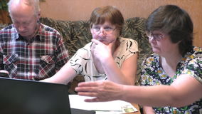 Older people at the table with a notebook. At home stock video footage