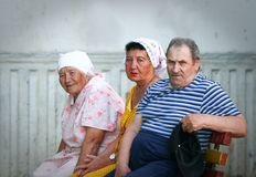 Older people: three Russian pensioners on a bench Royalty Free Stock Photography