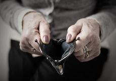 Older person holding money wallet open Royalty Free Stock Photo