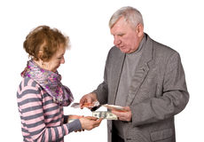 Older persons with money in hands Royalty Free Stock Image