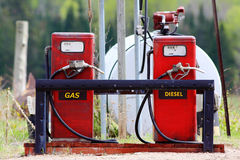 Older red gas pumps with diesel and gas. Fuel Stock Photo