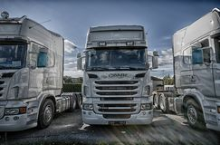Older Scania trucks outside the garage royalty free stock photography