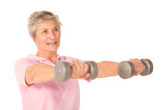 Older senior lady lifting weights Stock Photos