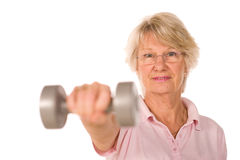 Older senior lady lifting weights Royalty Free Stock Image