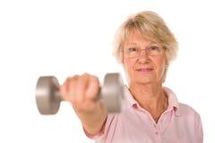 Older senior lady lifting weights Royalty Free Stock Image