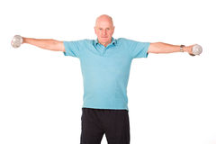 Older senior man lifting weights Royalty Free Stock Photography