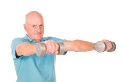 Older senior man lifting weights Royalty Free Stock Image