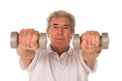 Older senior man lifting weights Stock Image