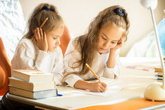 Older sister explaining homework to younger Royalty Free Stock Photos