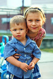 Older sister gently hugging her little brother Royalty Free Stock Photography