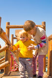Older sister helping younger one Royalty Free Stock Photo