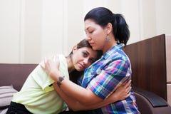 Older sister hugging her sister Stock Photos