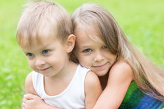 Older sister hugging little brother Royalty Free Stock Images