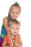 Older sister hugging a sibling. Children six and three years royalty free stock images