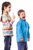 Older sister scolds his brother Royalty Free Stock Photography