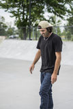 Older skateboard enthusiast skating around in skate park Stock Photography