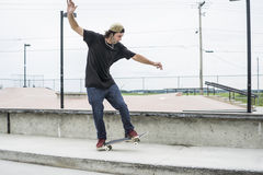 Older skateboard enthusiast skating around in skate park Stock Photo