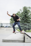 Older skateboard enthusiast skating around in skate park Royalty Free Stock Photo