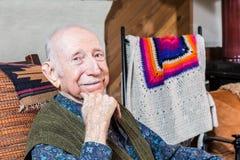 Older Smiling Gentleman Sitting Stock Photography