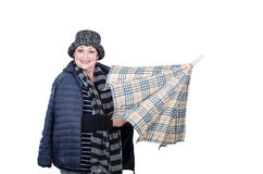 Older smiling woman opening plaid umbrella Royalty Free Stock Image