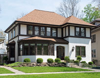Older Stucco Home with Brown Trim. Large, renovated, older, urban house with stucco siding & brown wooden trim Stock Image