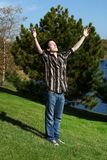 Older teen reaching for sky Stock Images
