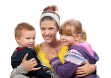 Older teen sister holding brother and sister Stock Image