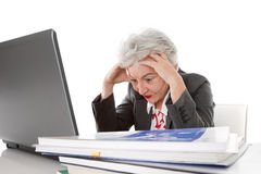 Older tired business woman may be all too much - isolated on wh Stock Photo