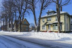 Wintertime Older Homes and Street. Older traditional houses in wintertime in a North American neighborhood Royalty Free Stock Photo