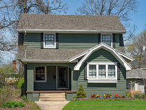 Older Two Story Home with Spring Flowers Royalty Free Stock Images