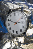 Older watch on ice Royalty Free Stock Images