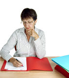 Older woman administrator at desk Royalty Free Stock Images