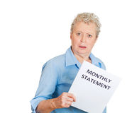 Older woman angered by her monthly statement Stock Images