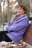 Older woman  in autumn park. Stock Photos