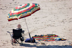 Older Woman on the Beach. In Denmark royalty free stock photo