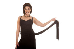 Older woman black dress hold tie Stock Image