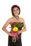 Older woman black dress holding flowers Stock Photo