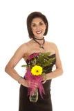 Older woman black dress holding flowers Stock Photo