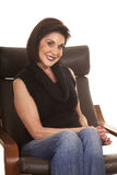 Older woman black top sit chair smile close Stock Photo