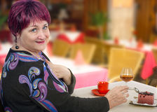 Older woman can not follow a diet Stock Images